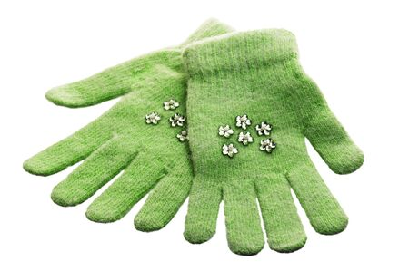 Green childrens gloves, it is isolated on white