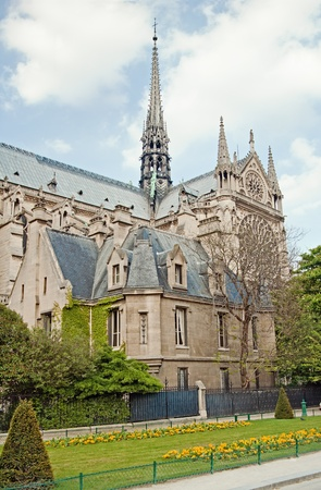 Notre Dame de Paris in spring time. View across the Seine River, France photo