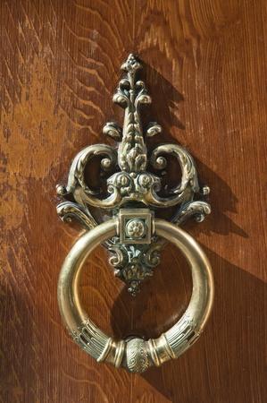 coppery wrought door knocker, bronze architecture detail