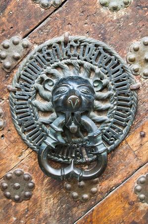 Ancient door knocker photo