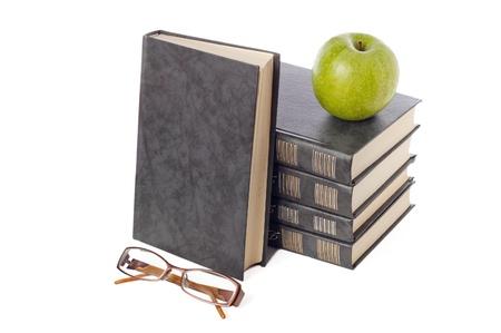 Pile of books isolated on white background photo