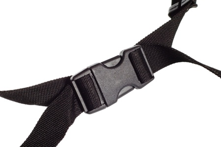 black plastic buckle on strap isolated on white photo