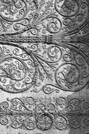 Fragment of a gate Notre Dame de Paris photo