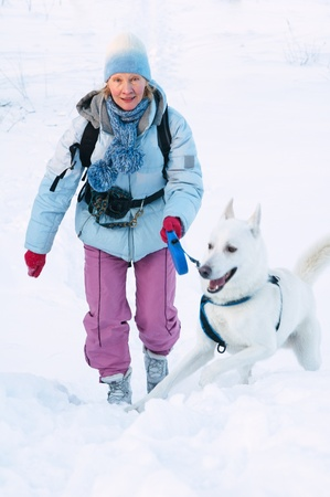The woman with a dog in winter on walk Stock Photo - 12248851