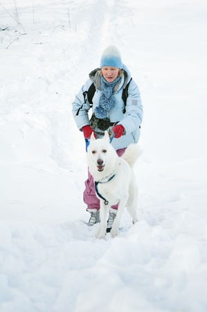 The woman with a dog in winter on walk photo