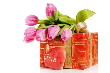 Pink tulips and gift box, it is isolated on white photo