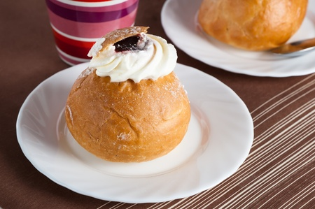 Rich rolls with a whipped cream,  easter bun Stock Photo - 12631967