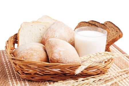 Bread, rolls and a glass of milk photo