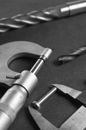 Details, drills and measuring tools, a close up photo