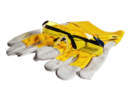 Yellow working goggles and gloves, it is isolated on white Stock Photo - 12879804