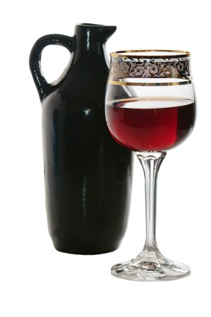 Black jug for wine and a glass of red wine photo