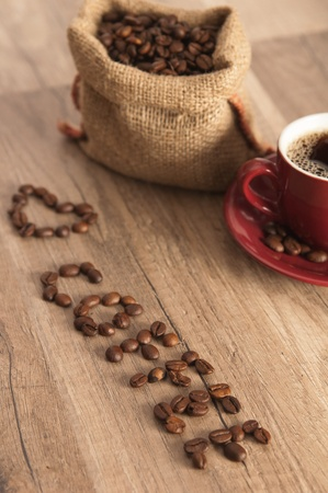 Grains of coffee on a wooden surface photo
