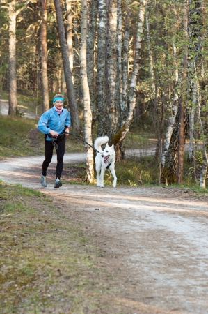 The sports woman with a dog run  in park Stock Photo - 13606408
