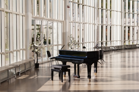 concert hall: Grand piano in the hall shined by the sun
