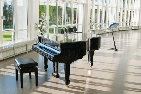 Grand piano in the hall shined by the sun photo