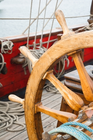 Steering wheel of an ancient sailing vessel Stock Photo