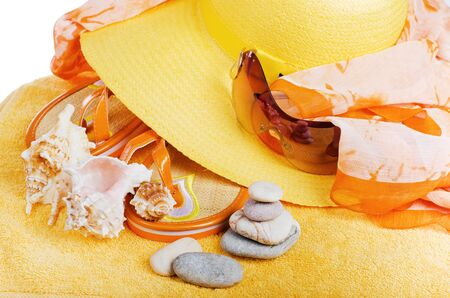 Beach  items a hat, a towel and slippers, it is isolated on white photo