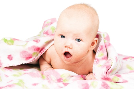 Little baby under multicolored towel Standard-Bild