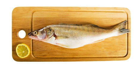 Pike perch on a wooden kitchen board, it is isolated on white Stock Photo - 15542210