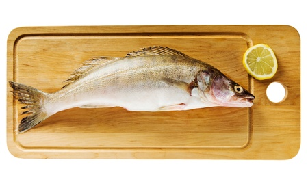 Pike perch on a wooden kitchen board, it is isolated on white Stock Photo - 15542208