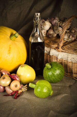 close up of onions in a basket: Still-life with vegetables in rural style Stock Photo
