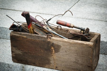 old wooden box with tools photo