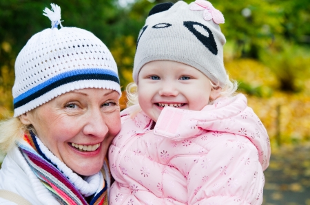 grandmother with the grand daughter in autumn park photo