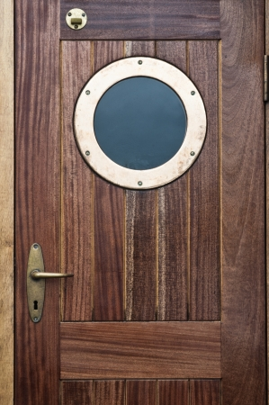 Old ship door with a window photo