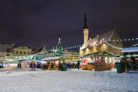 TALLINN, ESTONIA - DECEMBER 09  People enjoy Christmas market in Tallinn on December 09, 2012 in Tallinn , Estonia  It is Estonia oldest Christmas Market with a very long history dating back to 1441