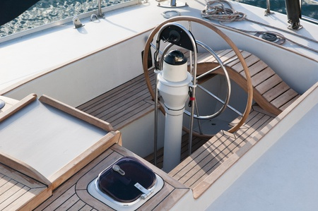 Steer and compass on sailing boat