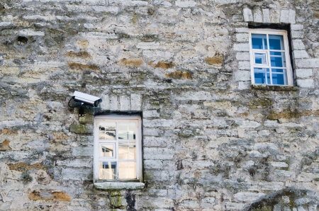 closed circuit: The chamber of video observation on a wall of a building near a window