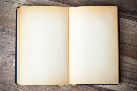 open old book on a wooden surface Stock Photo - 18708666