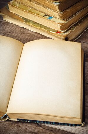 open old book on a wooden surface Stock Photo - 18708653