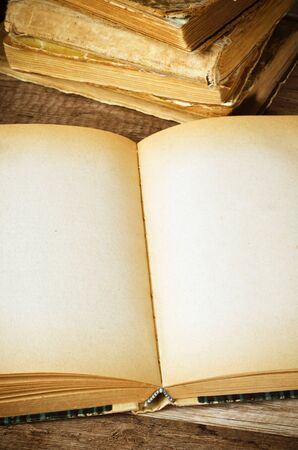 open old book on a wooden surface Stock Photo - 18708655