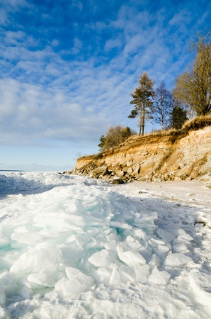 North Estonian limestone shore on a sunny winter day photo