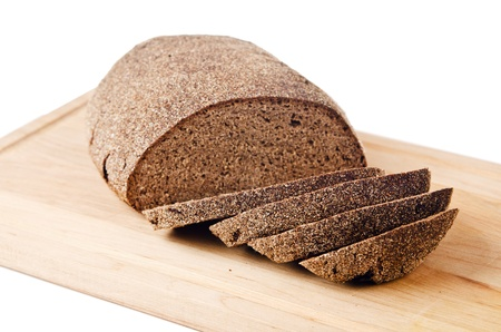 Black homemade bread, isolated on white photo