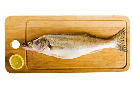 Pike perch on a wooden kitchen board, it is isolated on white Stock Photo - 20201995
