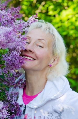 Portrait of a woman from a Bush blooming lilac photo