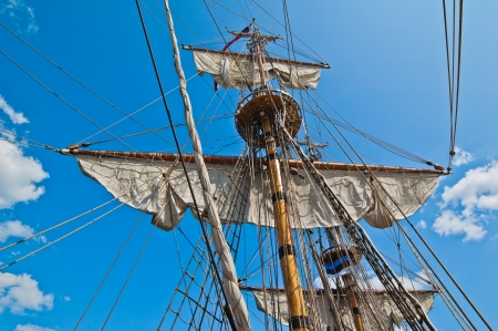 brig: Mast with sails of an old sailing vessel Stock Photo