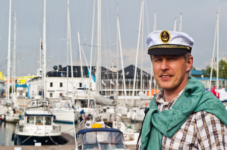 Portrait of a man in a sailors Cap on the deck of a sailboat photo