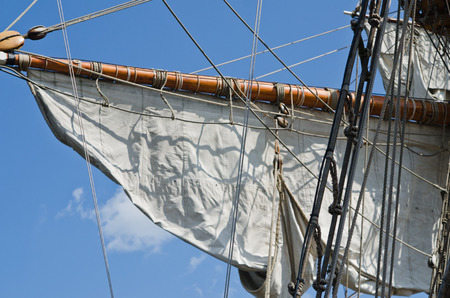 Mast with sails of an old sailing vessel photo