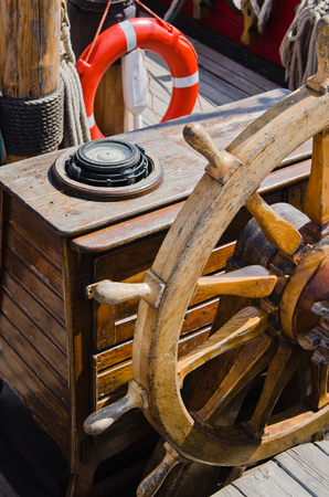 Steering wheel of an old sailing vessel, close up photo