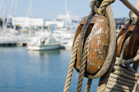 Blocks and rigging at the old sailboat, close-up photo