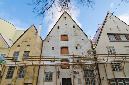 renovate old building facade: The facade of old buildings requiring restoration