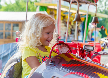 A child riding a children's attraction