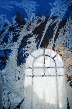 Frost on the window of the chapel photo