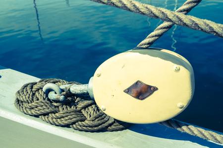 cross process: Blocks and tackles of a sailing vessel. Cross process Stock Photo