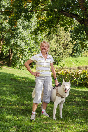 Woman with a dog on a walk in the park photo