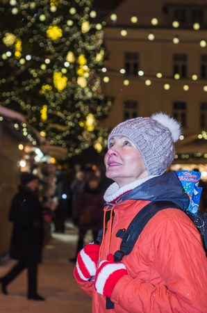 town hall square: A woman looks at decorated Christmas Town Hall Square in Tallinn
