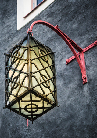 lamp: Beautiful lantern on a wall of the house in Old Tallinn Stock Photo